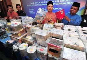 Sebahagian daripada tabung derma yang dirampas di Kuala Lumpur semalam.
