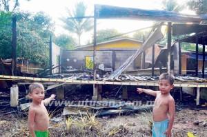 BIARPUN baru berusia lima tahun, Mohd. Syawal Mohd. Shukri (kanan) menjadi 'hero' apabila berjaya menyelamatkan dan membawa keluar adiknya