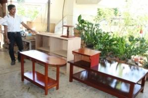 AWANG Hashim bin Besar menunjukkan sebahagian dari perabut yang dihasilkannya.
