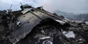 Puing pesawat Malaysia Airlines yang membawa 298 orang dari Amsterdam ke Kuala Lumpur yang jatuh di Kota Shaktarsk, timur Ukraina, Kamis (17/8/2014).