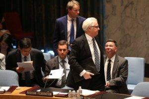 Duta Besar Rusia untuk PBB, Vitaly Churkin, meninggalkan sidang darurat DK PBB membahas penembakan MH17. (Credit: AFP)